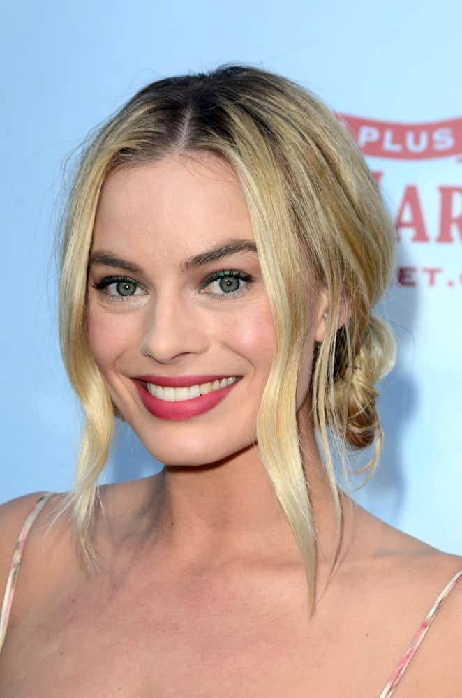 "On February 3, 2018, Margot Robbie arrived for the ""Peter Rabbit"" Premiere at the Pacific Theaters at The Grove. She wore a messy loose bun hairstyle incorporated with tendrils."