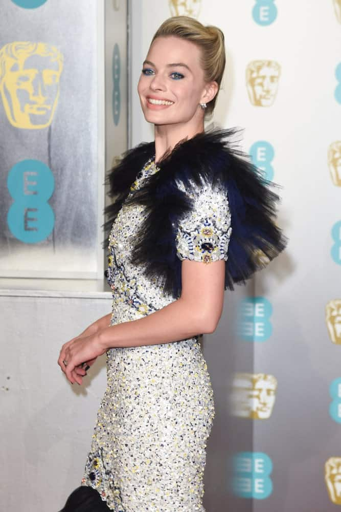 Margot Robbie exhibited a retro-glam look featuring her stylish slicked upstyle and edgy beaded gown at the BAFTA Film Awards 2019 on February 10, 2019.