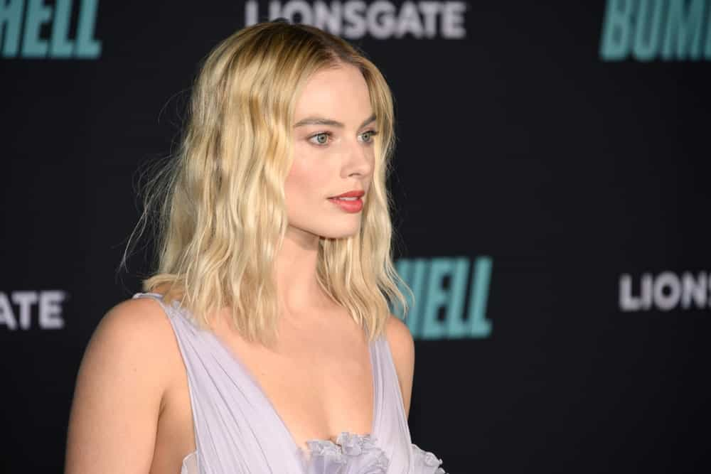 "Margot Robbie with her short tousled blonde waves at the special screening of Liongate's ""Bombshell"" held at Regency Village Theatre on December 10, 2019."
