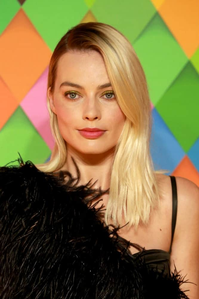 Margot Robbie looked fabulous in a fur dress that contrasts her loose blonde locks styled with a deep side part during the 'Birds of Prey' world premiere at the BFI IMAX last January 29, 2020.