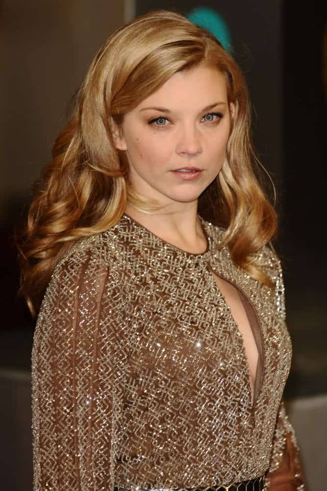 Natalie Dormer exhibited a retro look featuring her voluminous side-parted waves at the EE BAFTA Film Awards 2013 held at the Royal Opera House, Covent Garden, London on October 2, 2013.