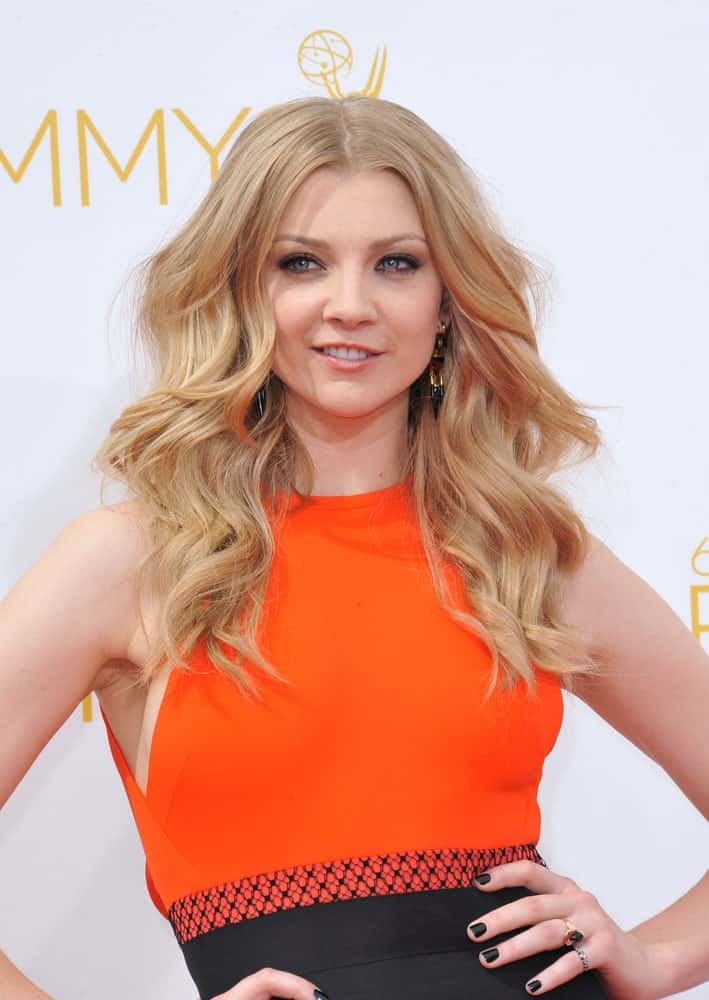 Natalie Dormer pulled off a tousled layered wavy hairstyle to pair with her vibrant halter dress during the 66th Primetime Emmy Awards at the Nokia Theatre L.A. Live downtown Los Angeles last August 25, 2014.