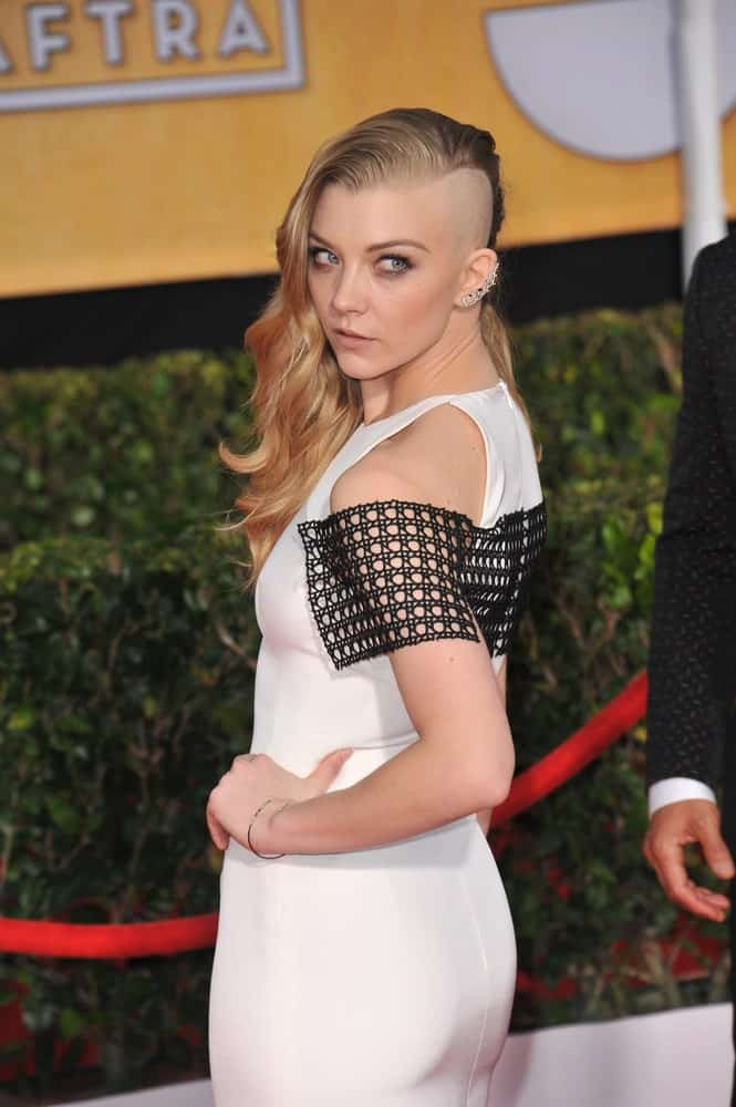 On January 18, 2014, Natalie Dormer attended the 20th Annual Screen Actors Guild Awards at the Shrine Auditorium. She channeled her inner badass with an edgy side-swept hairstyle where the left side of her head is shaved.