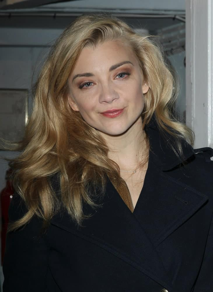 Natalie Dormer wearing a black coat and a voluminous side-swept hairstyle as she leaves the Theatre Royal in London last October 27, 2017.