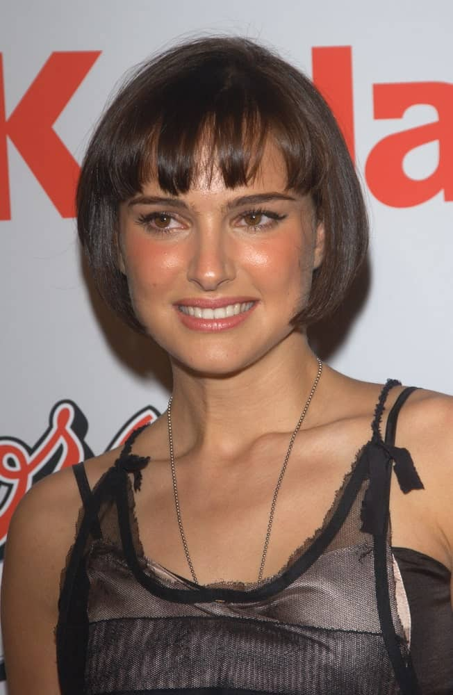 Actress Natalie Portman paired her black cheer outfit with a short chin-length hairstyle that has short blunt bangs at the Los Angeles premiere of her new movie Cold Mountain on December 7, 2003.