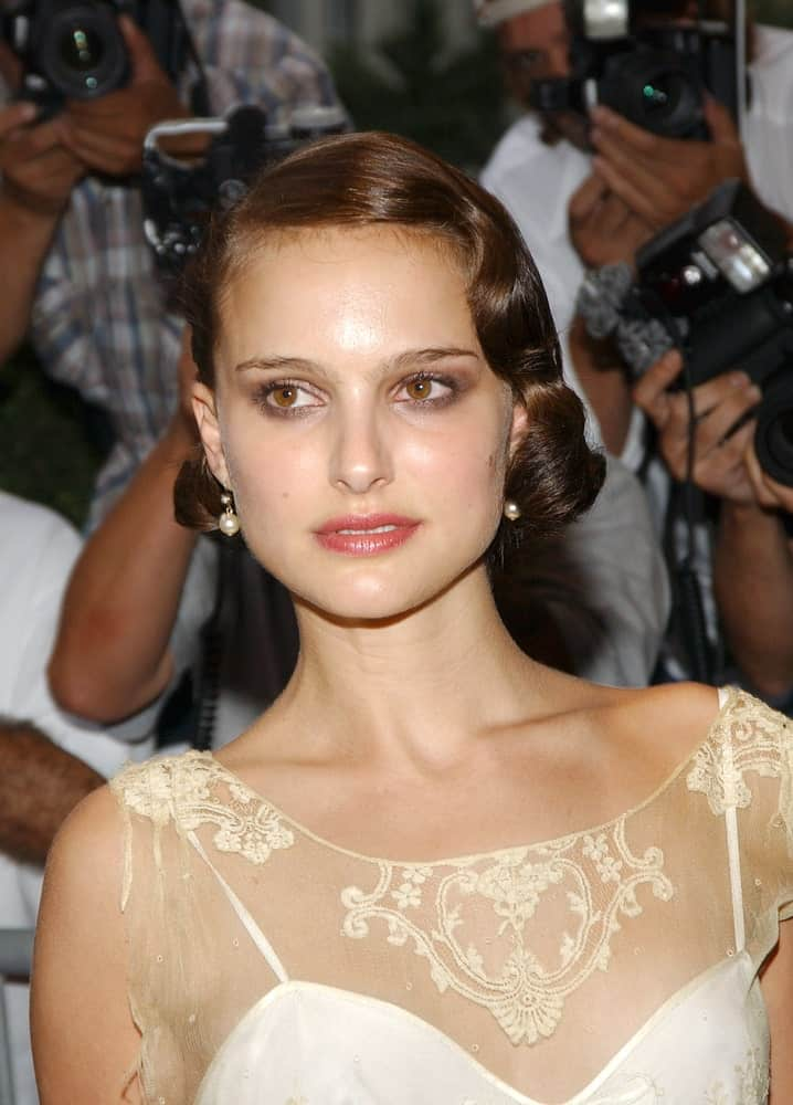 Natalie Portman went with a vintage look to her white sheer dress and short dark hairstyle that has pins, side-swept bangs, and vintage curls when she attended the Premiere of GARDEN STATE in New York City on July 27, 2004.