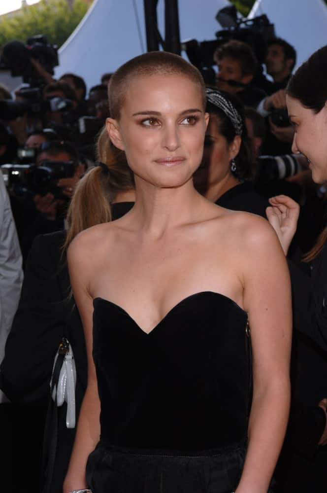 Actress Natalie Portman sported a buzz cut with her stunning strapless black outfit at the gala premiere of her movie Star Wars – Revenge of the Sith at the 58th Annual Film Festival de Cannes on May 15, 2005, in Cannes, France.
