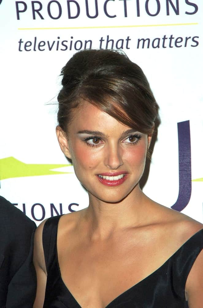 Natalie Portman went with a vintage look to her black dress and upstyle with long side-swept bangs at the 2007 Vision Awards from JTN Productions at the Beverly Hills Hotel in New York, NY on October 08, 2007.