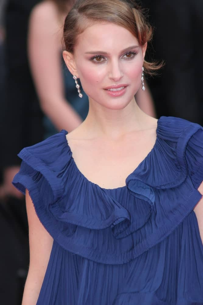 Juror Natalie Portman attended the La Silence de Lorna premiere at the Palais des Festivals during the 61st Cannes Film Festival on May 19, 2008, in Cannes, France. Her blue dress was perfectly paired with a unique bun hairstyle on the side.