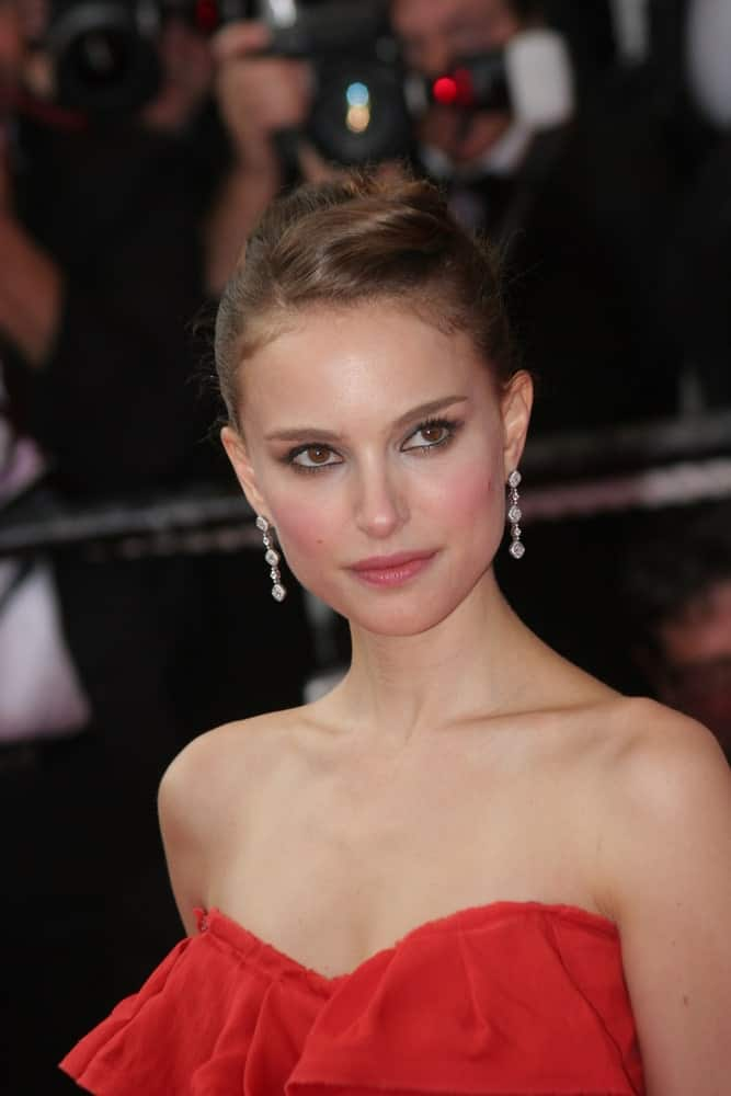 Natalie Portman's beautiful diamond earrings were on full display with her strapless red dress and elegant upstyle with a slick finish at the 'Che' Premiere at the Palais des Festivals during the 61st Cannes International Film Festival on May 21, 2008, in Cannes, France.