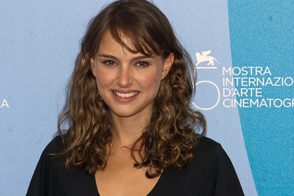 Director Natalie Portman attended the Eve photocall at the Piazzale del Casino during the 65th Venice Film Festival on September 2, 2008, in Venice, Italy. She wore a simple black outfit that complements her medium length loose and tousled curly hairstyle with bangs.