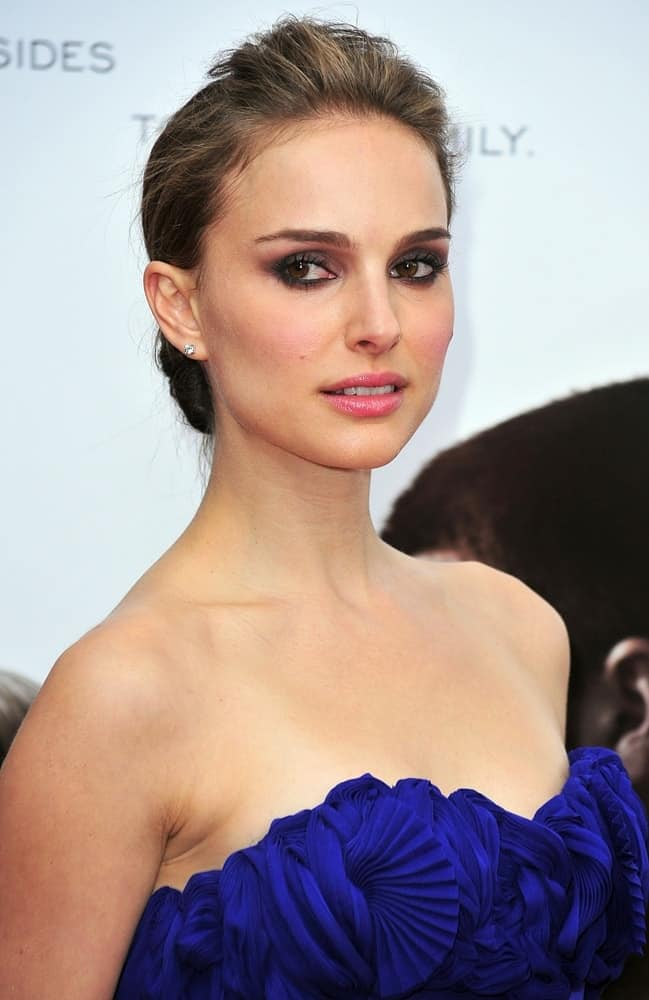 "Natalie Portman attended the ""Brothers"" New York Premiere at the School of Visual Arts, SVA, Theater in New York, NY on November 22, 2009. She was quite lovely in her blue strapless dress and low bun hairstyle with a slight tousle at the top for a pompadour look."