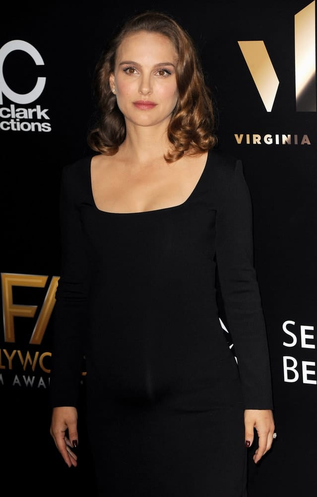 Natalie Portman wore an elegant black dress with her loose shoulder-length brown curly hair at the 20th Annual Hollywood Film Awards held at the Beverly Hilton Hotel in Beverly Hills, USA on November 6, 2016.