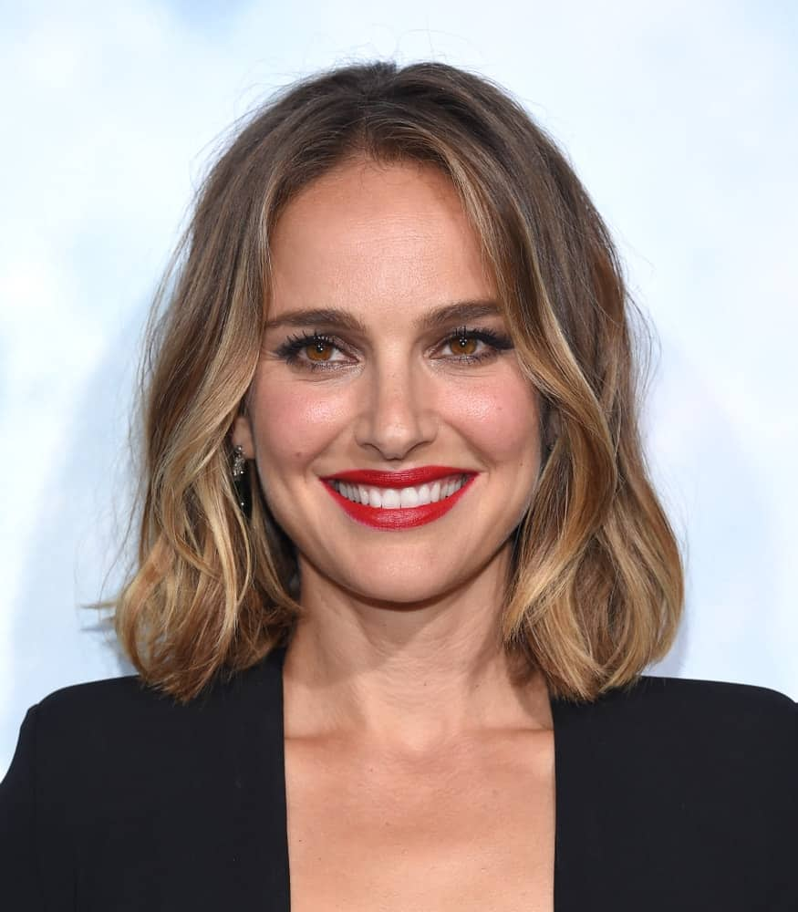 """Natalie Portman attended the """"Lucy In The Sky"""" Los Angeles Premiere on September 25, 2019, in Los Angeles, CA. She was quite sophisticated in her simple black outfit, bold red lips and highlighted wavy bob hairstyle."""