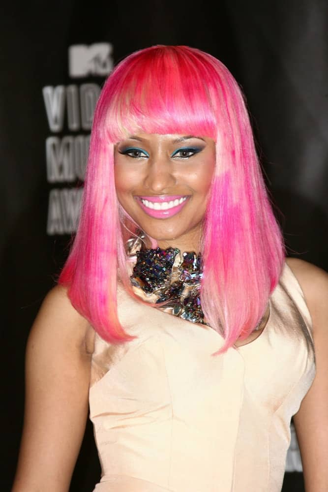 Nicki Minaj was quite lovely in her bright dress and straight layered pink hairstyle with blunt bangs at the 2010 MTV Video Music Awards Press Room, Nokia Theatre L.A. LIVE in Los Angeles, CA on August 12, 2010.