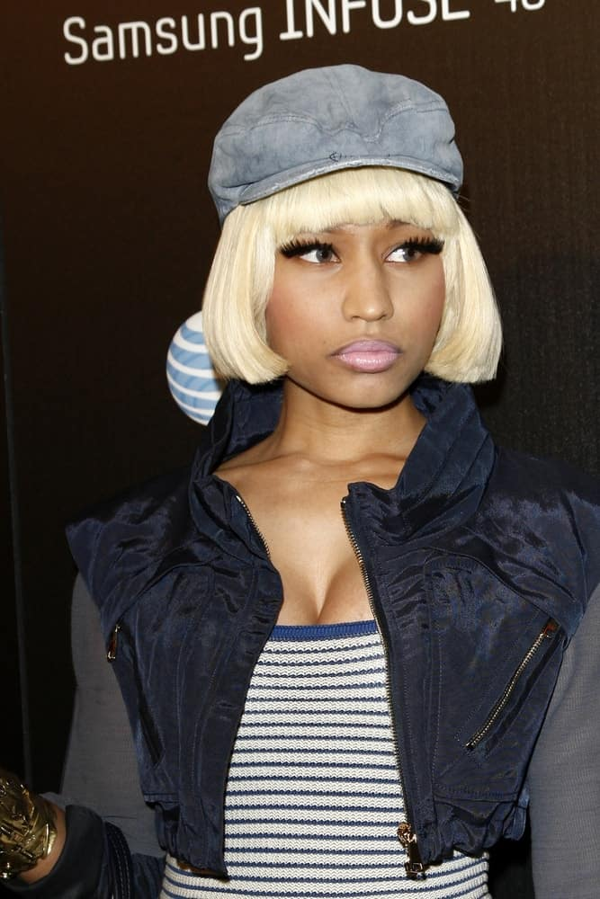 Nicki Minaj went with a simple and casual look to her ensemble outfit and chin-length straight blond hairstyle with blunt bangs at the Samsung Infuse 4G For AT&T Launch Event at Milk Studios on May 12, 2011, in Los Angeles, CA.
