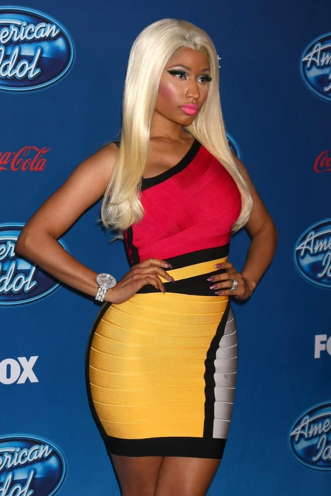 Nicki Minaj attended the 'American Idol' Premiere Event at Royce Hall, UCLA on January 9, 2013 in Westwood, CA. She wore a colorful short dress that went well with her long and straight blond hairstyle loose on her shoulders.