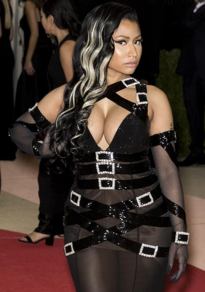 On May 2, 2016, Nicki Minaj attended the Manus x Machina Fashion in an Age of Technology Costume Institute Gala at the Metropolitan Museum of Art in New York. She went with a black sheer outfit to pair with her side-swept curly raven hairstyle with blond highlights.
