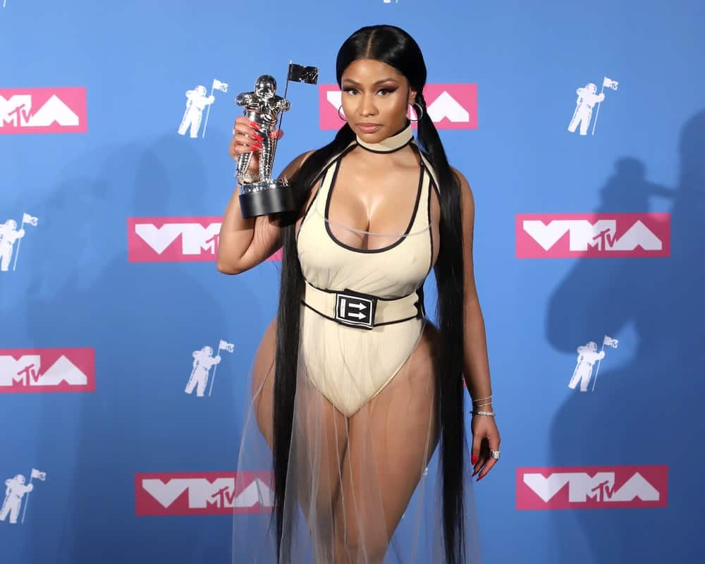Nicky Minaj attended the MTV Video Music Awards at Radio City Music Hall on August 20, 2018, in New York. She complimented her sexy curves with a long and straight raven hairstyle styled into twin ponytails.