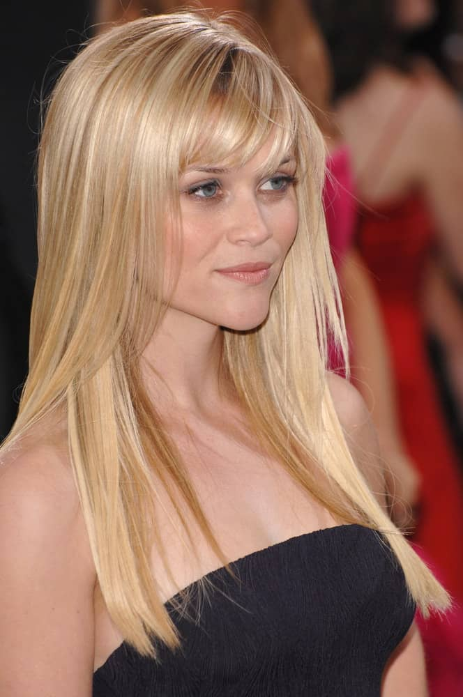 Reese Witherspoon's simple strapless black dress was complemented by her long and straight blond hairstyle that has subtle highlights and bangs as well as layers at the 79th Annual Academy Awards at the Kodak Theatre, Hollywood on February 26, 2007, in Los Angeles.