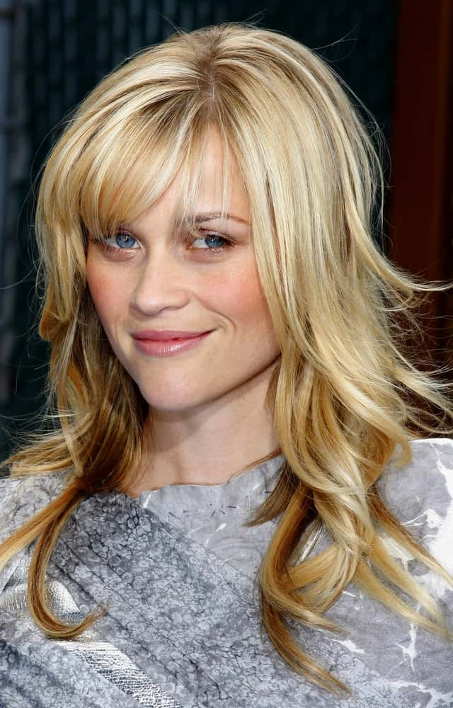 Reese Witherspoon's tousled and highlighted loose blond hairstyle had wispy bangs at the Los Angeles premiere of 'Monsters vs. Aliens' held at the Gibson Amphitheatre in Universal City on March 22, 2009.