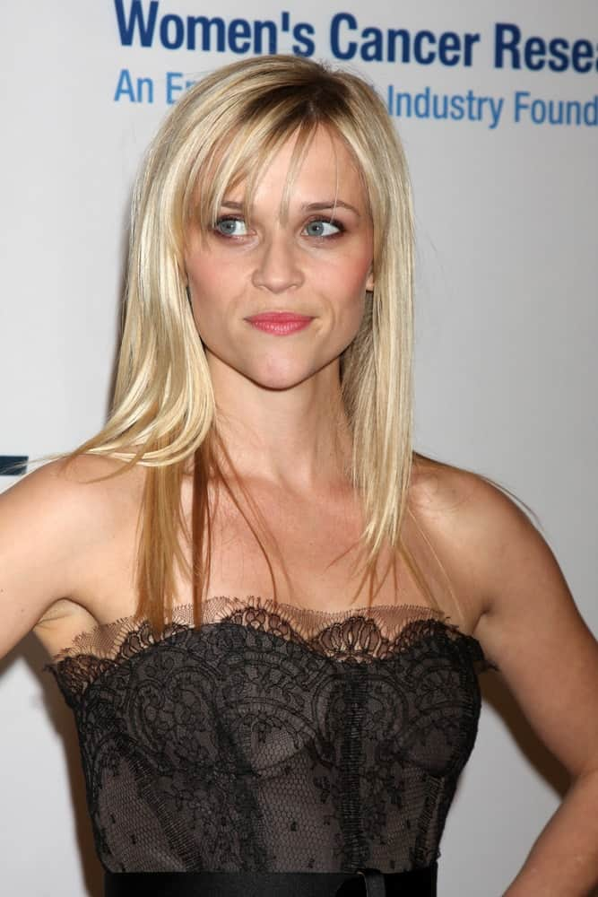 """Reese Witherspoon was at the """"An Unforgettable Evening"""" benefiting EIF's Women's Cancer Research Fund on January 27, 2010, in Los Angeles, California. She was lovely in her black strapless dress and her straight and loose blond hair with highlights and wispy bangs."""