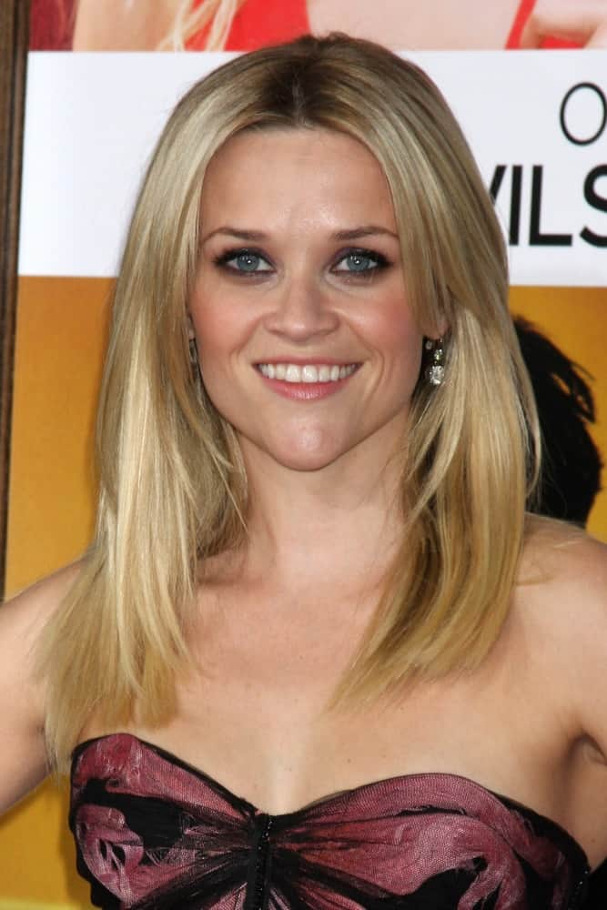 Reese Witherspoon was quite charming in her strapless dress and loose, layered and straight sandy blond hairstyle at Heather Tom's Annual Christmas Party 2010 at the Village Theater on December 13, 2010, in Westwood, CA.