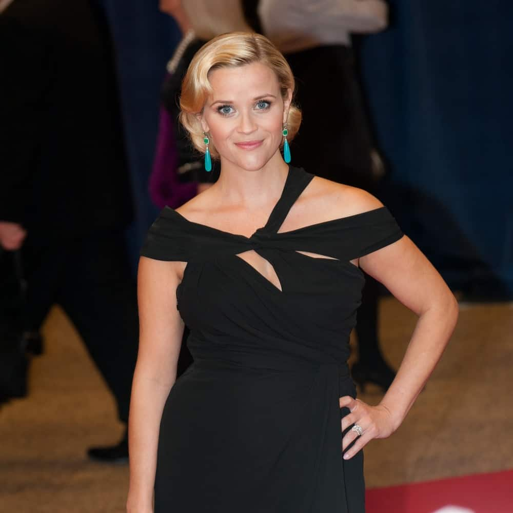 Actress Reese Witherspoon was at the White House Correspondents Dinner on April 28, 2012, in Washington, D.C. She wore a black dress that went well with her pregnant belly and vintage blond curly half-up look that has long side-swept bangs.