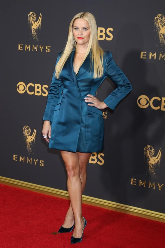 Reese Witherspoon wore a smart blue dress to pair with her long, center-parted silky straight blond hair at the 69th Primetime Emmy Awards – Arrivals at the Microsoft Theater on September 17, 2017, in Los Angeles, CA.