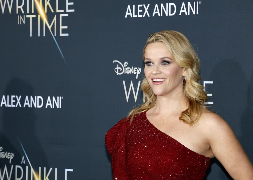 Reese Witherspoon was quite charming in her red sequined dress and side-swept wavy blond hairstyle that has highlights and layers at the Los Angeles premiere of 'A Wrinkle In Time' held at the El Capitan Theater in Hollywood, USA on February 26, 2018.