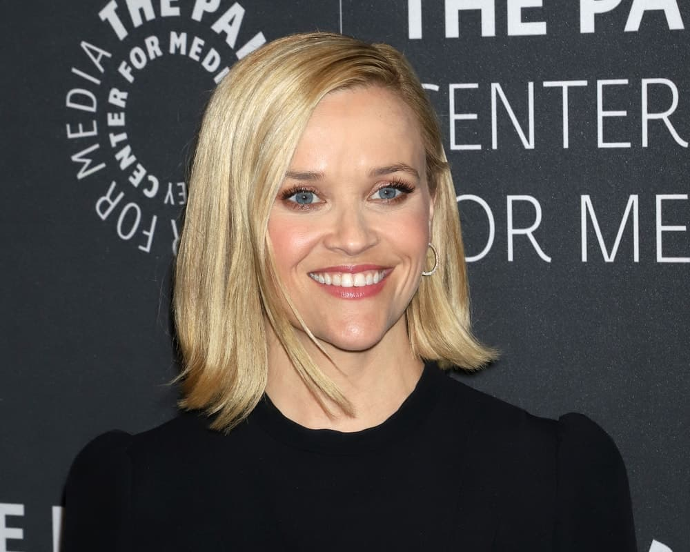 "Reese Witherspoon attended the promotional event for ""The Morning Show"" on October 30, 2019, in New York. She wore a simple black dress that was complemented by her slick and straight side-parted blond bob hairstyle."