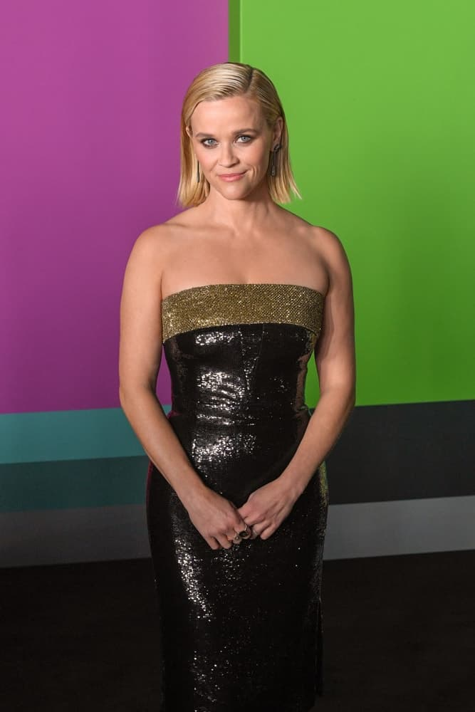 "Actress Reese Witherspoon attended the Apple TV+'s ""The Morning Show"" World Premiere at David Geffen Hall on October 28, 2019, in New York City. She wore a gorgeous black sequined dress to pair with her slick and straight short blond hairstyle."