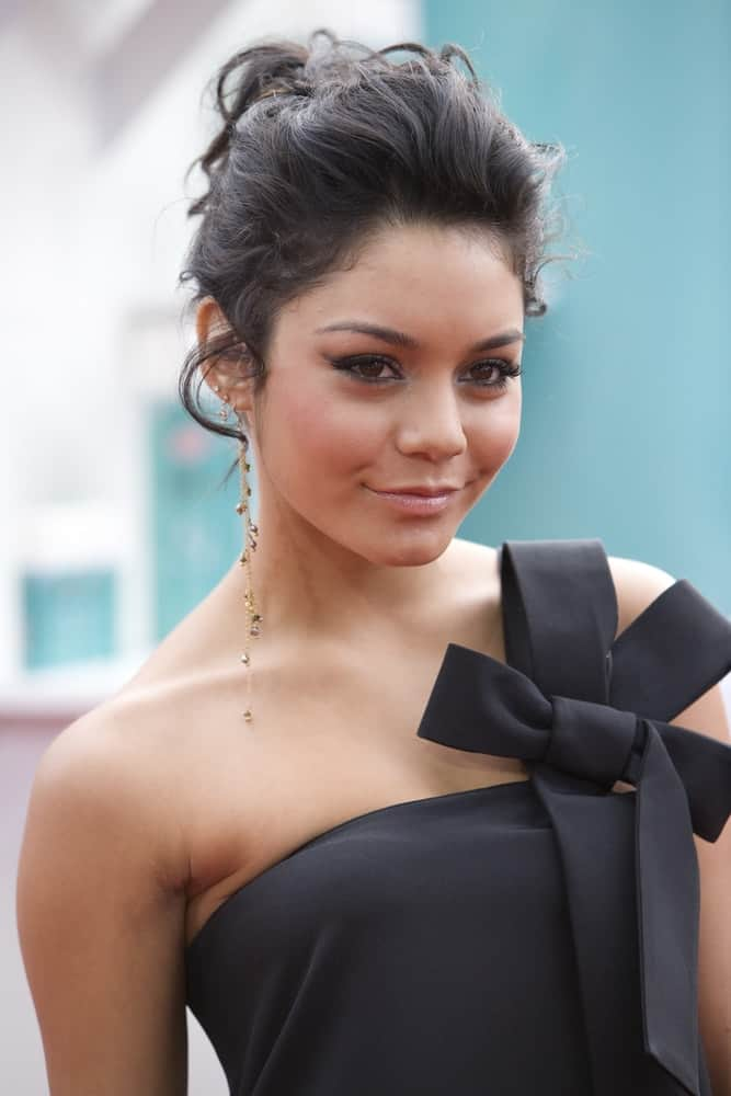 Actress Vanessa Anne Hudgens was at the premiere of 'Hairspray' on July 10th, 2007 in Westwood, Los Angeles. She wowed the crowd with her stunning black dress and messy raven bun hairstyle with a slight tousle and loose tendrils.