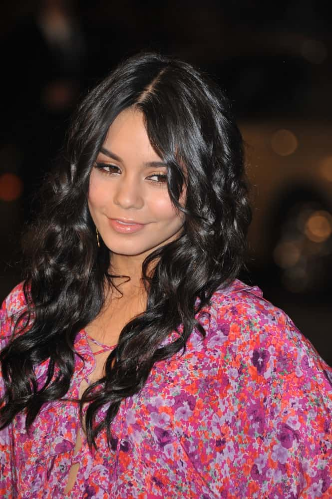 "On March 2, 2009, Vanessa Hudgens attended the US premiere of ""Watchmen"" at Grauman's Chinese Theatre, Hollywood. Her colorful floral outfit paired perfectly well with her long and loose wavy raven hairstyle with layered bangs."