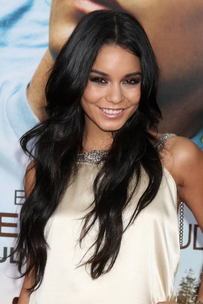 "Vanessa Hudgens attended the ""Charlie St. Cloud"" Premiere at Village Theater on July 20, 2010, in Westwood, CA. Her lovely white outfit that has silver jewels complemented her loose, long, wavy layered hairstyle that has a gorgeous raven tone to it."