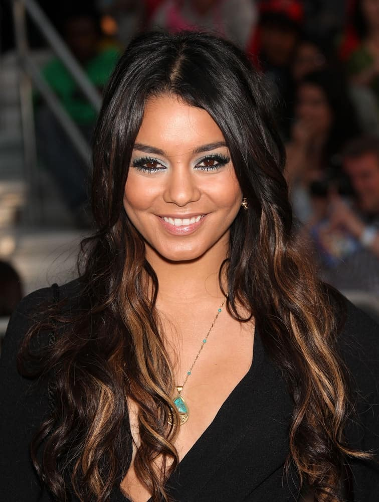 """Vanessa Hudgens's simple black outfit was complemented by her lovely make-up and long, loose wavy hairstyle with brown highlights when she arrived at the """"Pirates of the Caribbean: On Stranger Tides"""" World Premiere on May 7, 2011, in Anaheim, CA."""