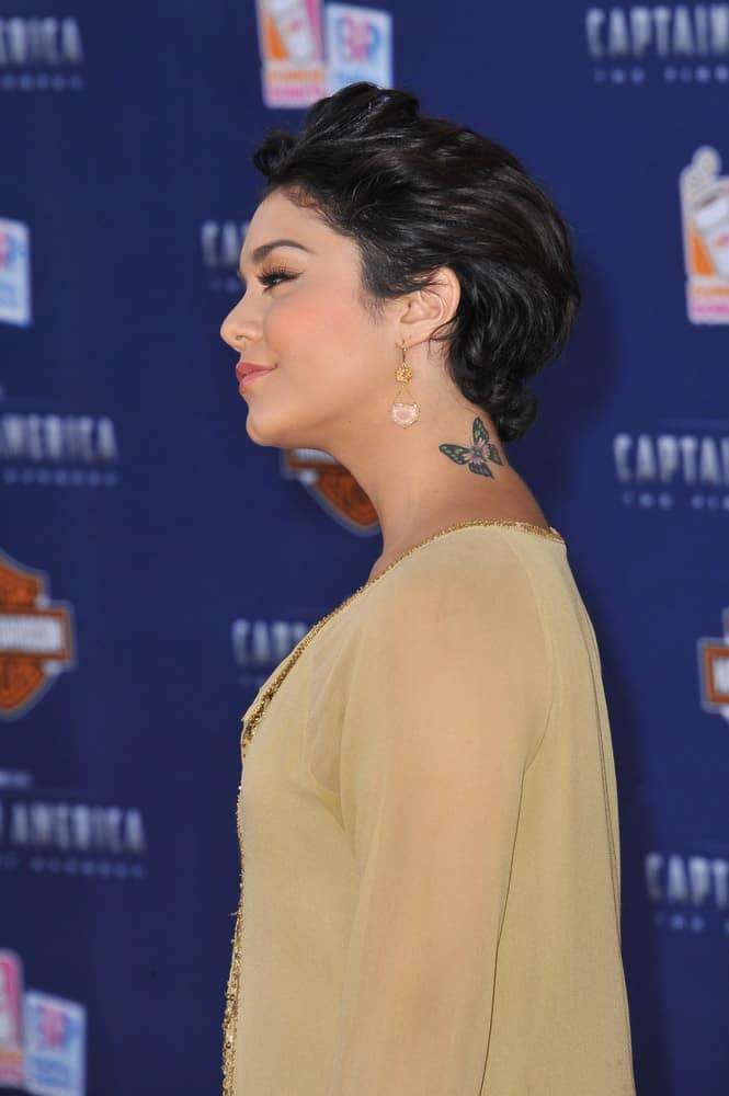 "Vanessa Hudgens was at the premiere of ""Captain America: The First Avenger"" at the El Capitan Theatre, Hollywood on July 19, 2011, Los Angeles, CA. She was charming in her tan sheer outfit to go with her brushed-back short raven hairstyle."