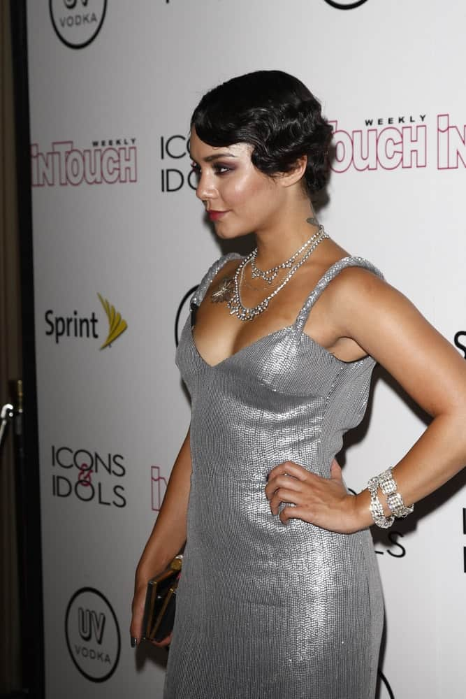 Vanessa Hudgens wore a gorgeous silver dress that she wore confidently with her slick short raven hairstyle that has a vintage curl on the side at the 4th annual Icons & Idols party at the Sunset Tower Hotel in West Hollywood, California on August 28, 2011.