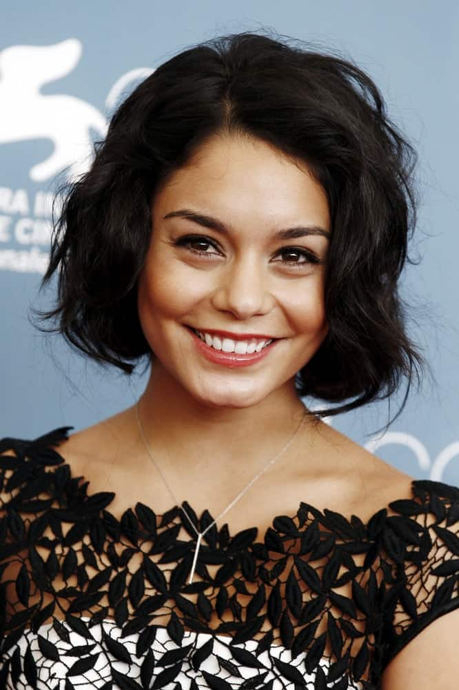 Actress Vanessa Hudgens attended the 'Spring Breakers' photo-call at the 69th Venice Film Festival on September 5, 2012, in Venice, Italy. She looked positively charming in her embroidered outfit, brilliant smile and short, tousled raven bob hairstyle with a wavy finish.