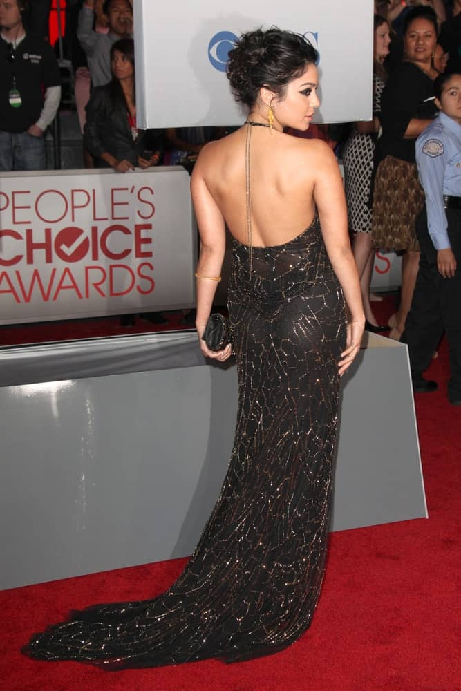 Vanessa Hudgens paired her gorgeous black dress and cat-eye make-up with an elegant upstyle bun hairstyle with a slightly tousled finish at People's Choice Awards 2012 at Nokia Theater at LA Live on January 11, 2012, in Los Angeles, CA.