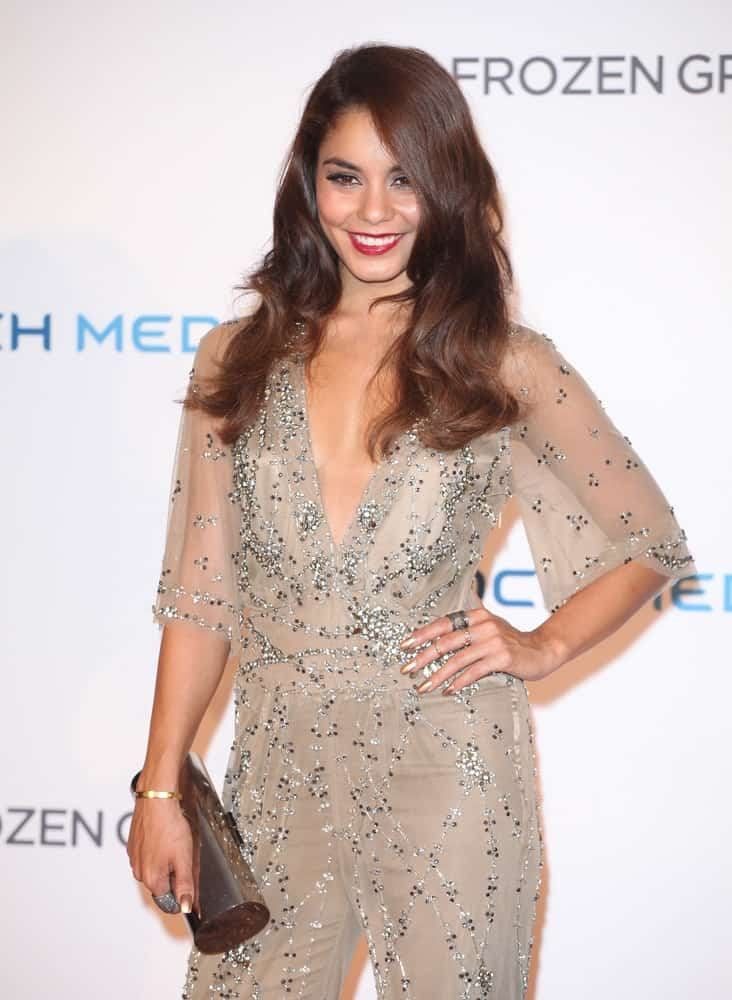 Vanessa Hudgens paired her sexy and fashionable gray sheer romper with a long and loose layered hairstyle that has a dark brown tone to it at The Frozen Ground UK Premiere, at Vue West End in London on July 17, 2013.