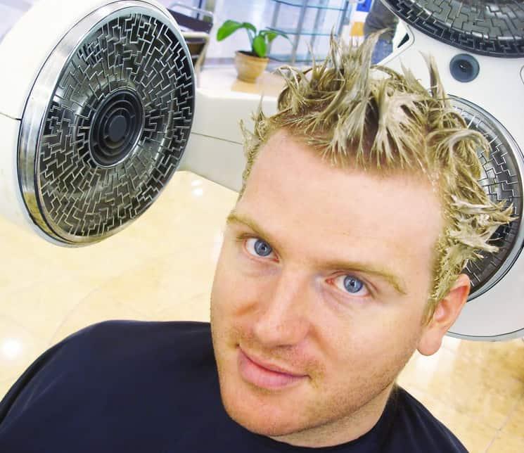 Man getting highlights in hair