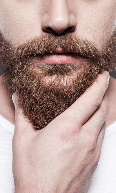 A man touching his beard.