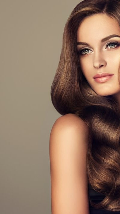 A woman with wavy brunette hair.