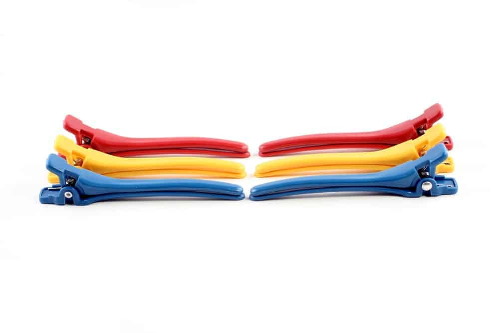A pair each of red, yellow, and blue hinged barrettes.