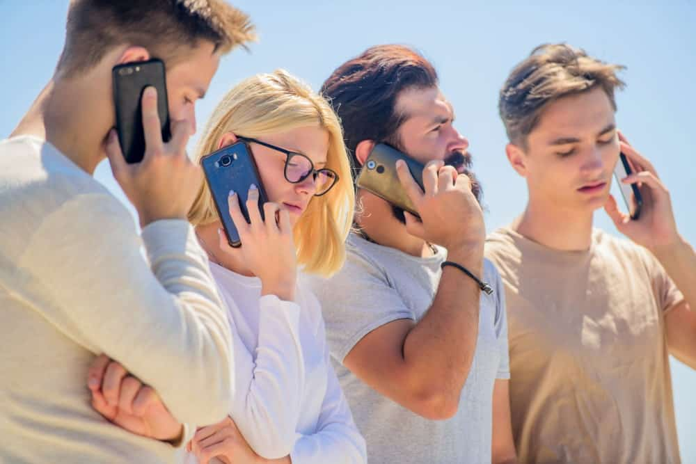 Young people on a call on their smartphones.