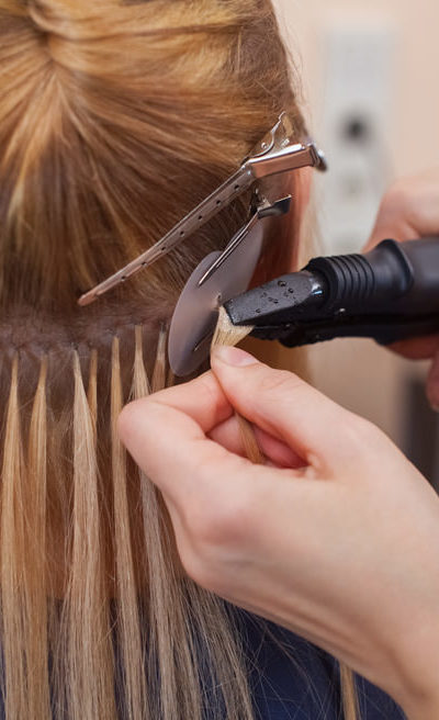 Hair extensions applied by professional stylist