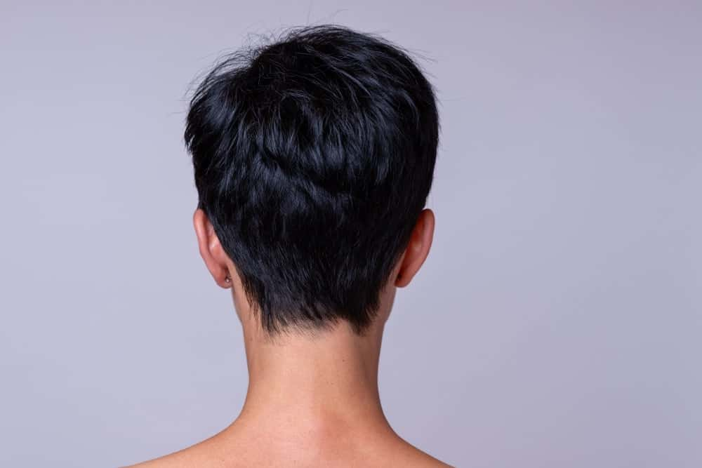 A woman with a boy cut hairstyle as seen from behind.