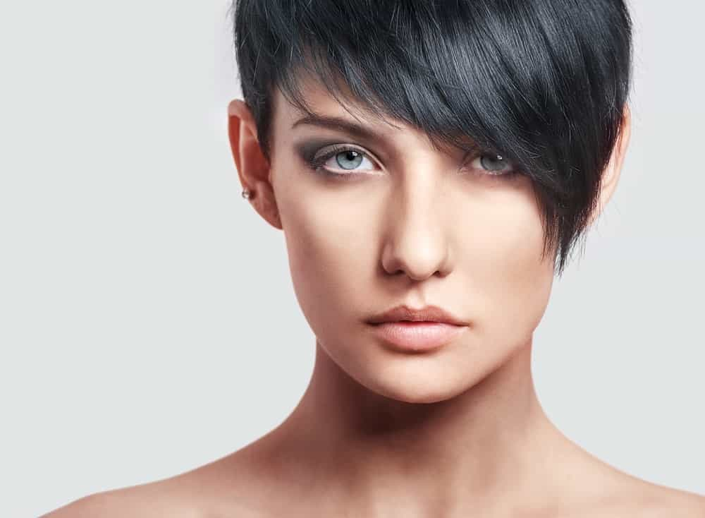 A close look at a woman with A-line pixie hairstyle.