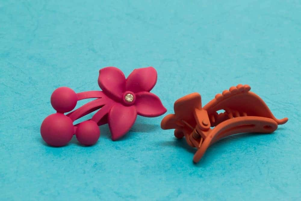 Mini-shaped hair clips on blue background.